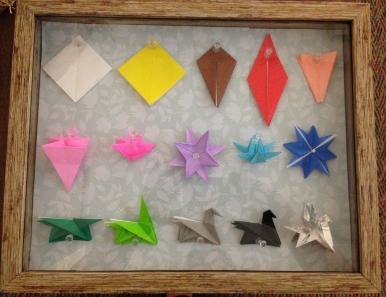 Fold progression of origami pegasus in 15 pieces of paper mounted in a shadow box