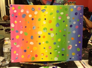 A variety of dots in different colors and sizes sprinkled evenly over the rainbow blending